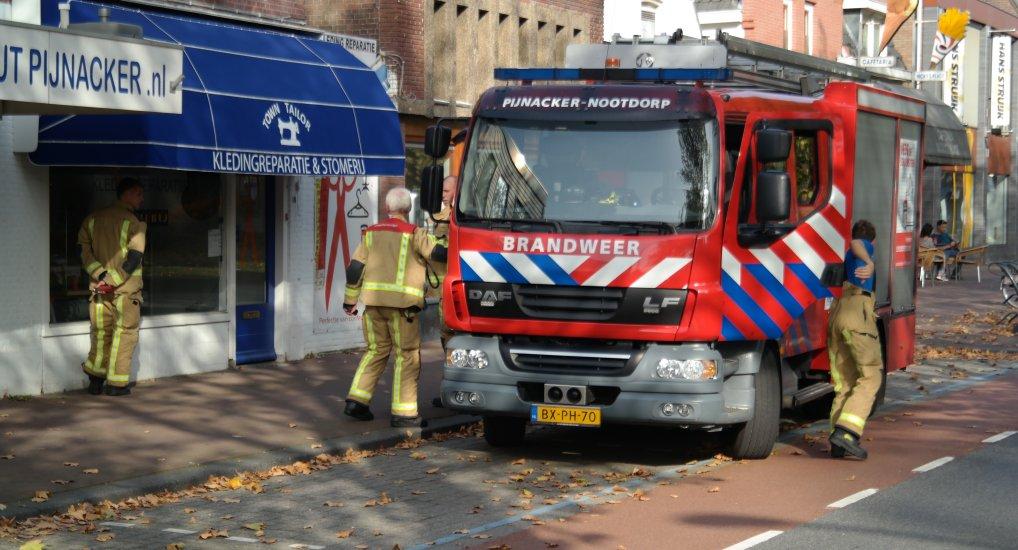 Brandgerucht bij kledingreparatie Westlaan.