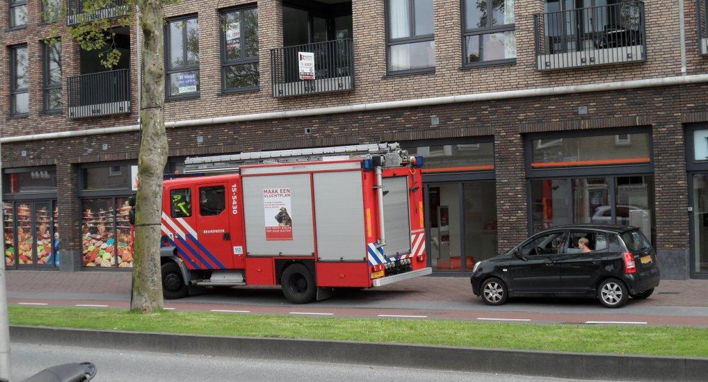 Brandgerucht Dominos Oostlaan.