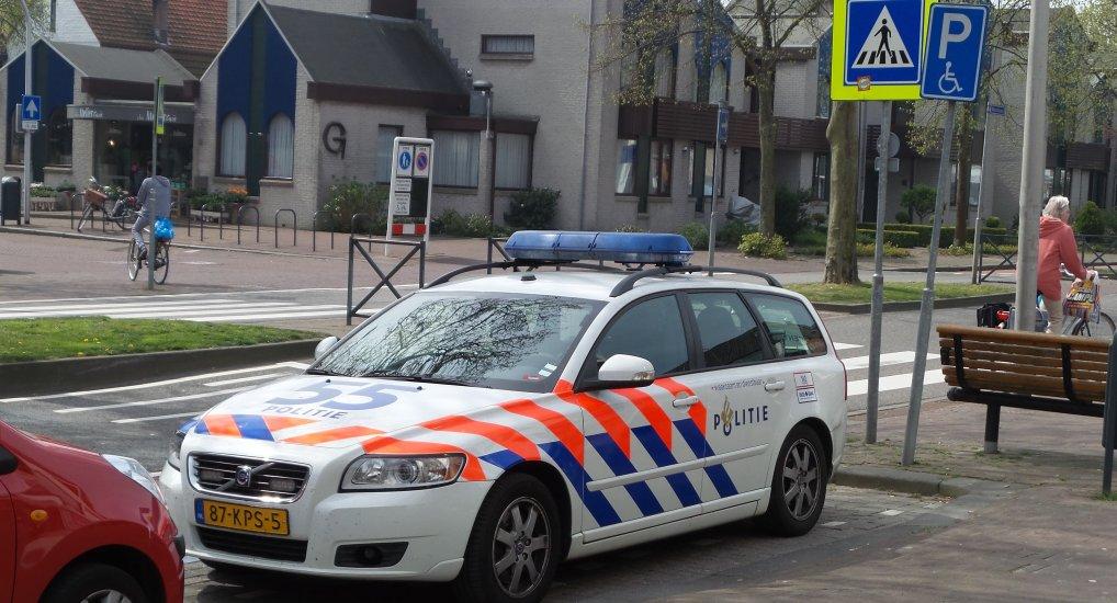 Politie op Invalide parkeerplaats.