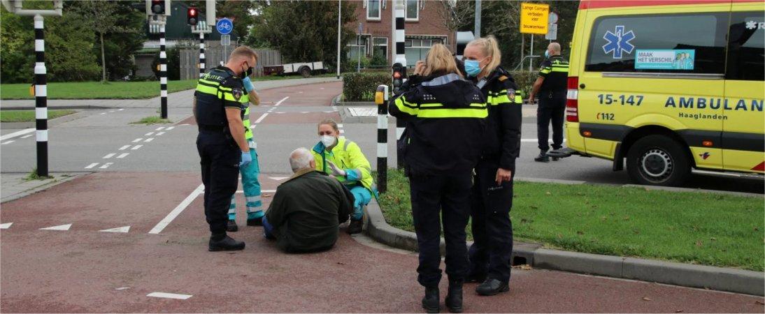 Fietser ten val Oostlaan-Vlielandseweg.